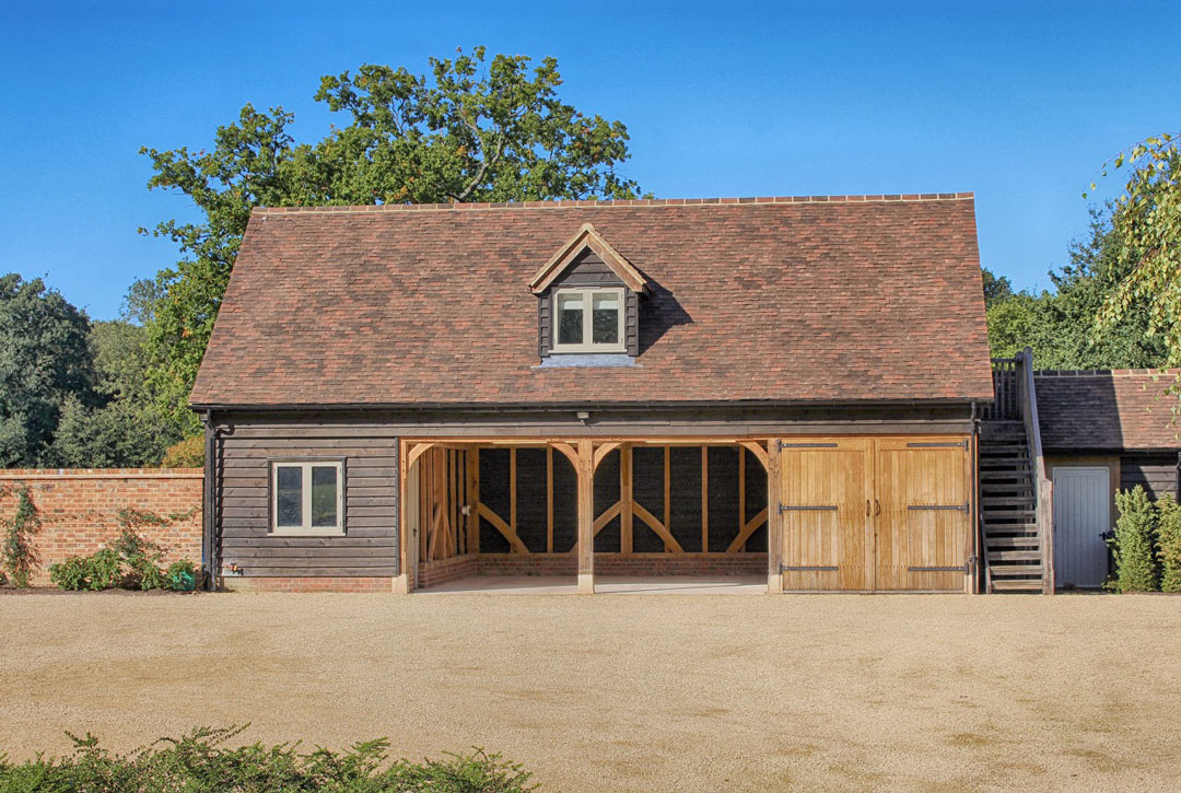 Three bay oak framed garage building with accommodation.